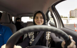A student at the female-only campus of Effat University, sits for the first time in the driver's seat, during training sponsored by Ford Motor, in Jiddah, Saudi Arabia, Tuesday, March 6, 2018. A stunning royal decree issued last year by King Salman announcing that women would be allowed to drive in 2018 upended one of the most visible forms of discrimination against women in Saudi Arabia. (AP Photo/Amr Nabil)