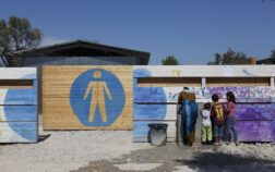 Women and children using the wash facilities at Kara Tepe camp on Lesvos action aid