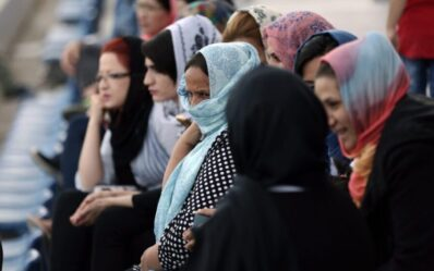 epa05862073 Women watch from the stands the celebrations of Nowruz, marking the first day of the New Year in the Iranian calendar, at the refugee camp in the former hockey Olympic Complex in Athens, Greece, 21 March 2017. Iranians, Afghans and Kurdish refugees living in the makeshift camp of Hellinikon, southern Athens, celebrated Nowruz (the Iranian New Year) 1396 (2017). The day, celebrated across cultures and national borders in western and central Asia, the Middle East and the Balkans, marks the first day of spring and the renewal of nature. Refugees gathered at the former hockey field and celebrated with live traditional music and dancing, with the support of the Community of United Afghanis in Greece.  EPA/SIMELA PANTZARTZI